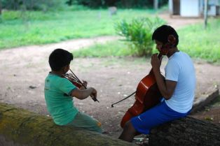 The children stay at the music school all day, often organising themselves into groups and learning from each other.