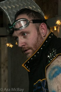 a man with goggles and a metal mohawk