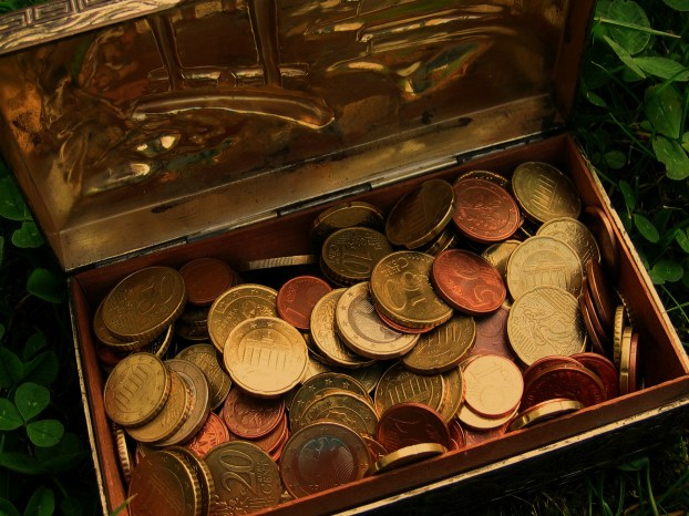 a treasure chest with many coins