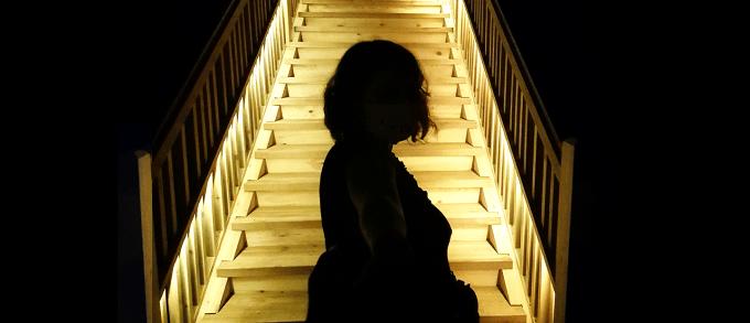 Woman leading her companion through the Wieliczka salt mine in Poland.