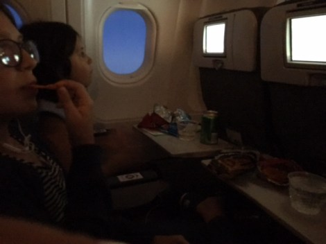 Girls enjoying final flight which included a tv:)