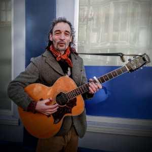 Pok, one of Glastonbury's many musicians. Photo by Vicki Steward