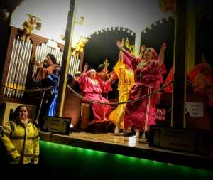 Glastonbury Carnival Float, people dressed in brightly coloured nun's habits dancing in a silly way