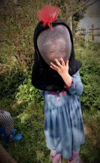 Small girl, large Kendo helmet.