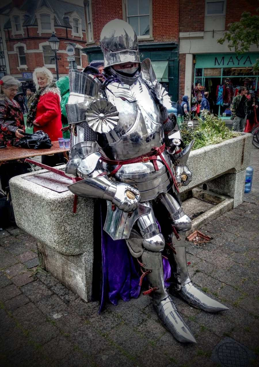 Man in armour on Glastonbury Market Cross, Beltane 2017