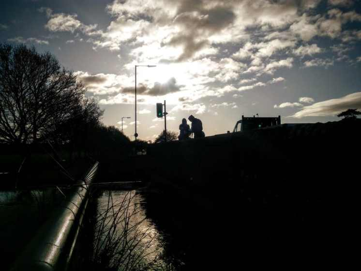 Making offerings at Pomparles Bridge, Glastonbury