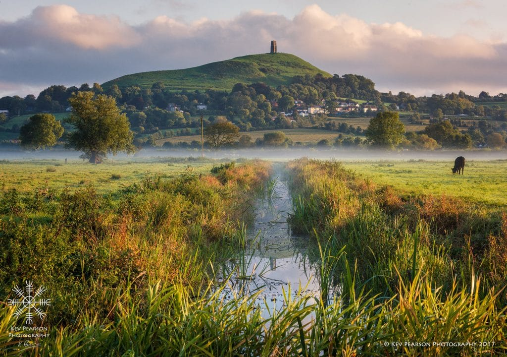Impressions by Kev Pearson. Glastonbury Tor reflected in water.