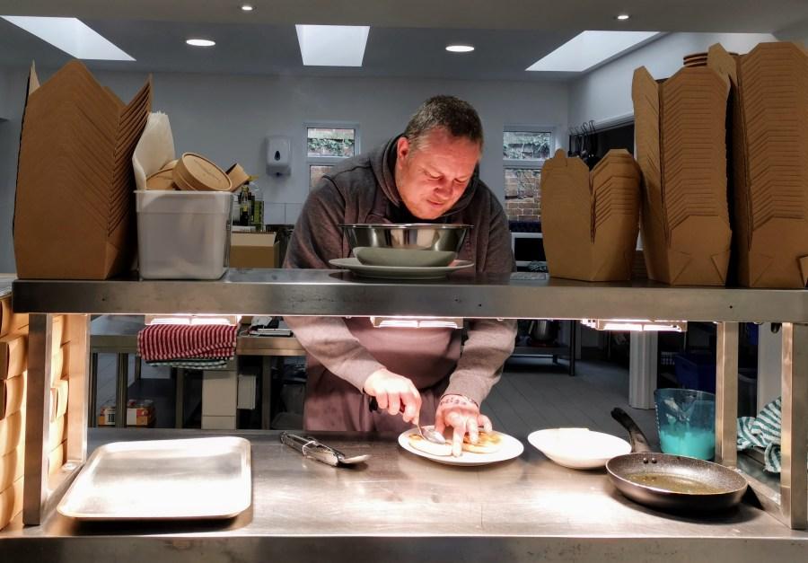 Chef Giles prepares breakfast at Benedict Street Kitchen