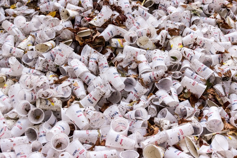 Single use plastic coffee cups disposed of