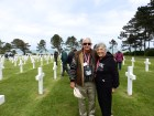 An American couple pose for a photo after having paid their respects