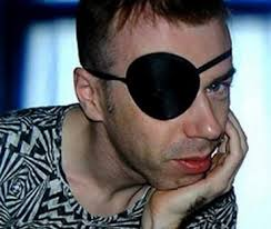 Momus - the eyepatch is real, not costume