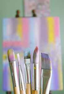 shallow focus photo of paint brushes