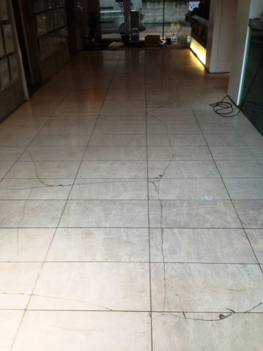 Repairing Cracked Limestone Floor Tiles   Stone Cleaning and     Damaged Limestone Tiled Floor in Wilmslow Before