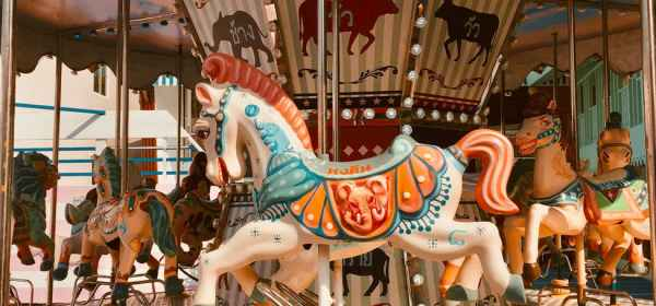 white and blue horse carousel