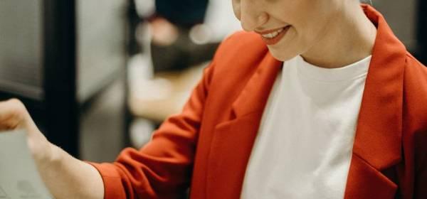 woman wearing red blazer