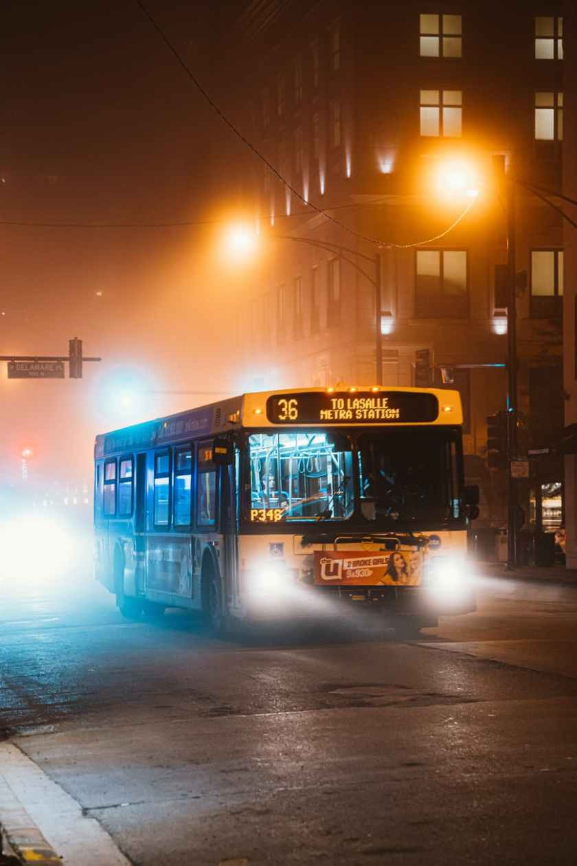 photo of bus during evening
