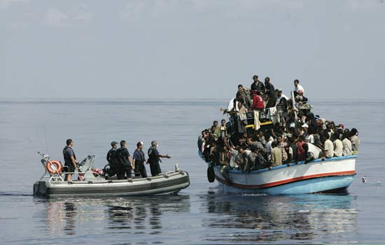 Immigrants travelling dangerously, since it is illegal for them to go via airplane to Europe