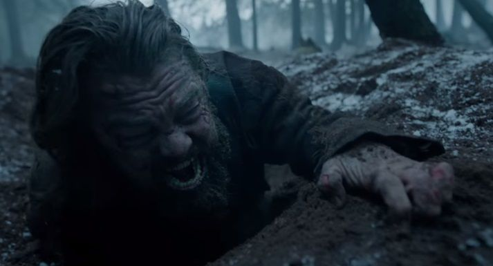 Hugh Glass (Leonardo DiCaprio) crawling out of his shallow grave in painful agony