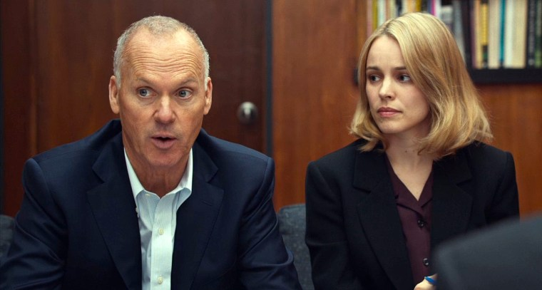 Walter Robinson (Michael Keaton) and Sacha Pfeiffer (Rachel McAdams)