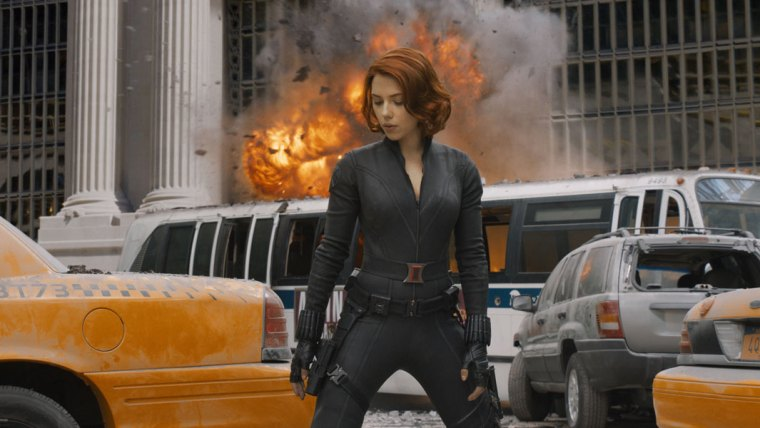 Black Widow's hair remains perfect and her posture stationary, despite the building behind her blowing up (The Avengers, Marvel Studios)