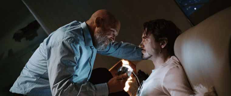 Obadiah Stane (Bridges) and Tony Stark (Downey Jr) (Iron Man, Marvel Studios)