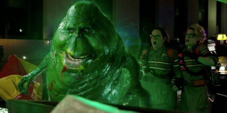 The classic Slimer with Abby Yates (McCarthy) and Jillian Holtzmann (McKinnon) (Ghostbusters, Universal Pictures)