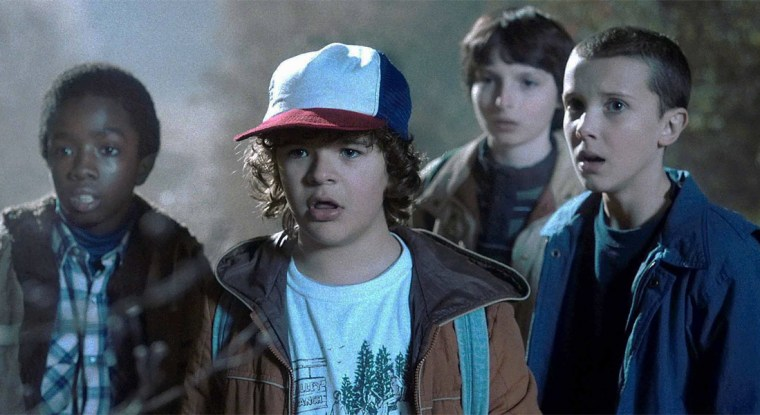 Lucas (McLaughlin), Dustin (Matarazzo), Mike (Wolfhard) and Eleven (Brown) (Stranger Things, Netflix)