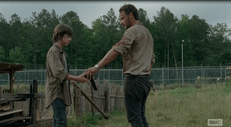 Carl Grimes (Chandler Riggs) with his father and leader Rick Grimes (Andrew Lincoln) (The Walking Dead, AMC)