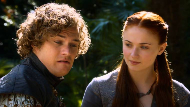 Ser Loras Tyrell (Finn Jones) and Lady Sansa Stark (Sophie Turner) in Kings Landing (Game Of Thrones, HBO)