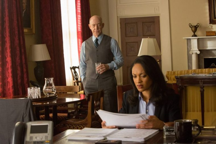 Ray (J.K. Simmons) with Agent (Cynthia Addai Robinson) in The Accountant (The Accountant, Warner Bros)