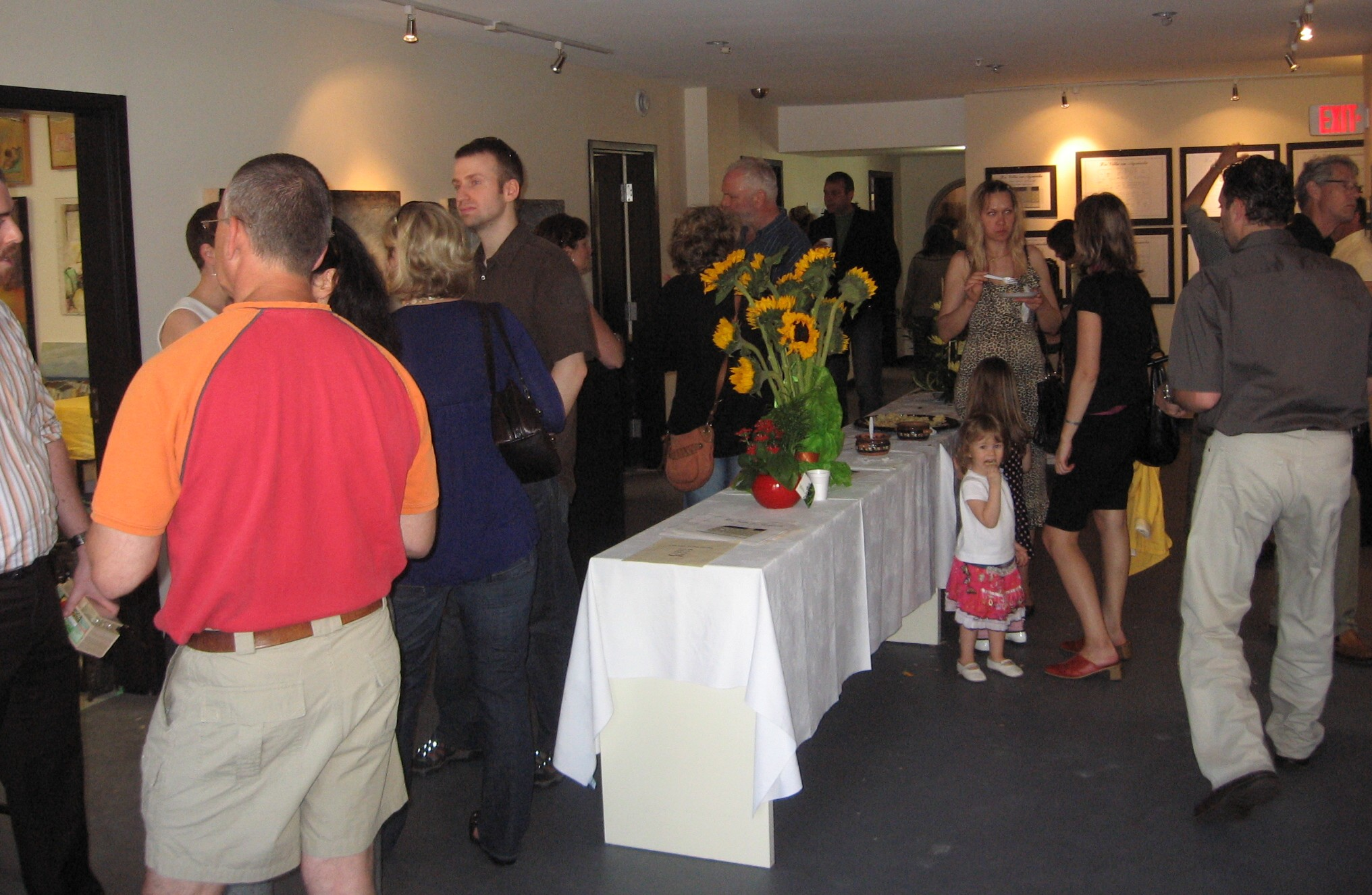 Guests mingle among the art studios and galleries.