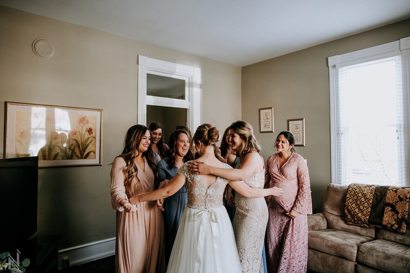 wedding photography in Old St. Charles, Missouri after first look with bridesmaids