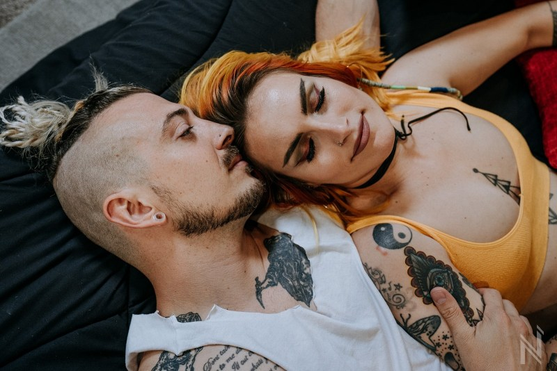 In home intimate lifestyle photo session of urban stylish alternative couple in downtown St. Louis