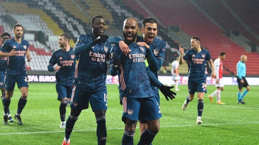 Lacazette and teammates celebrate his first goal of the evening, securing a semi-final spot