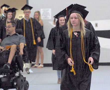 Katelyn Elizabeth Foster enters with the rest of the Class of 2017 Sunday during the Charles City High School graduation ceremony in the district's competition gym. -- Photo by Chris Baldus