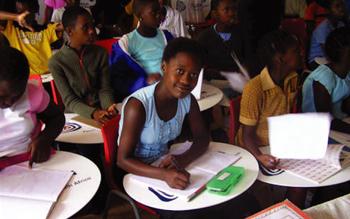 Children-writing-on-Tutu-desks-in-classroom