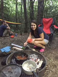 Girl cooking with Dutch Oven