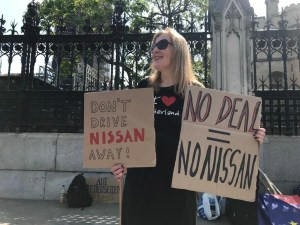 "Sunderland woman holding a ""No Deal = No Nissan"" placard."