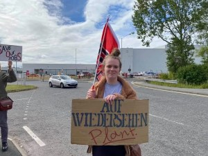 Local resident protesting outside Nissan plant