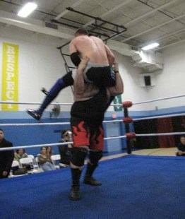 Dean Livsley powerbombs David Loomis in the NCW Championship Scramble.