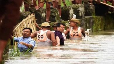 Photo of Manipur: IAS officer helping marooned people in waist-deep water