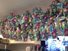 Zig-zagging across the ceiling at the new location of DiPasquale's Pasta Shoppe are dozens of hollow Easter eggs.