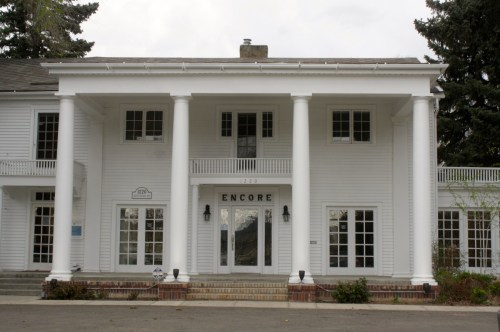 1220 South College was built in the Colonial Revival style in 1920. It was built by Edward Munroe, who made his money raising livestock. Note the flat roofed portico and large columns.