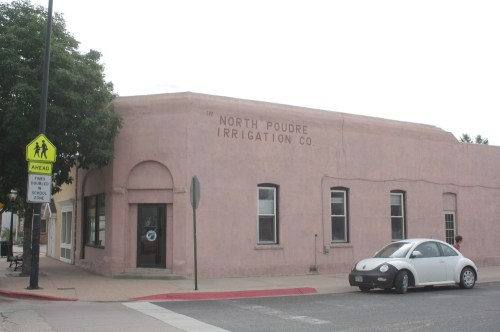 The old bank building is now the North Poudre Irrigation Company building. The arch over the corner entrance is one of the few give-a-ways that this is the same building.