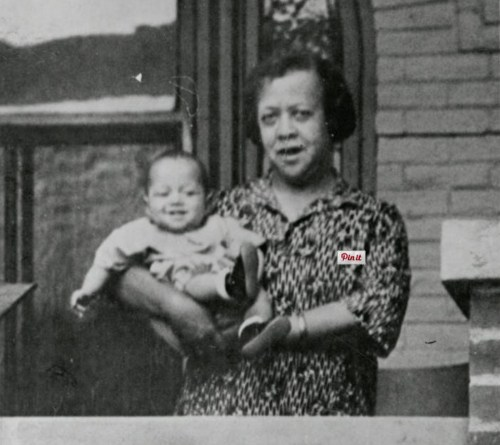 Dr. Justina Ford with one of the 7,000 babies she delivered in her lifetime. (Photo from the Denver Public Library Archive.)