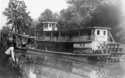 This photograph of the U.S. Coosa shows  a sternwheel towboat-packet with a wood hull, similar to boats that Jacob Flowers operated. (Photo from Ken McCulloch, via riverboatdaves.com.)