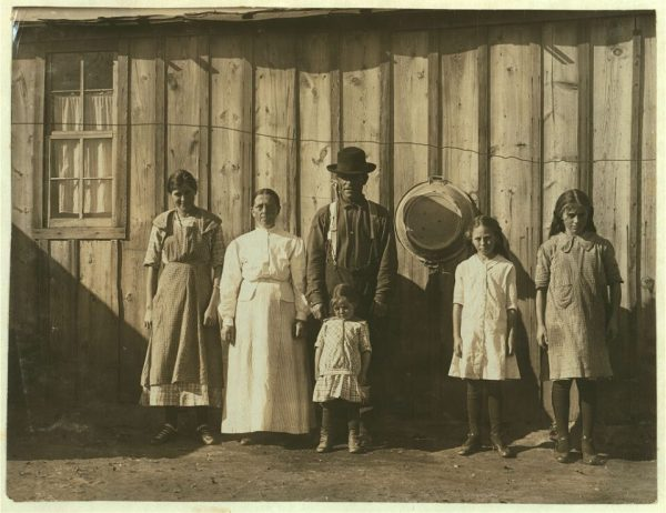 This family owned a house at 430 N. Loomis (which is still in existence). But for six months a year they'd board up the house and move into a shack in order to be nearer to the beet fields where they worked. Even the children helped in the fields. (Library of Congress - digital ID: nclc 00363)