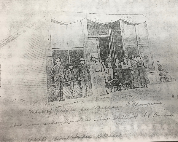 This photocopy of a photo of the store shows members of the Sheldon family as well as Thompsons. E. J. Thompson was the proprietor of the store for a time.