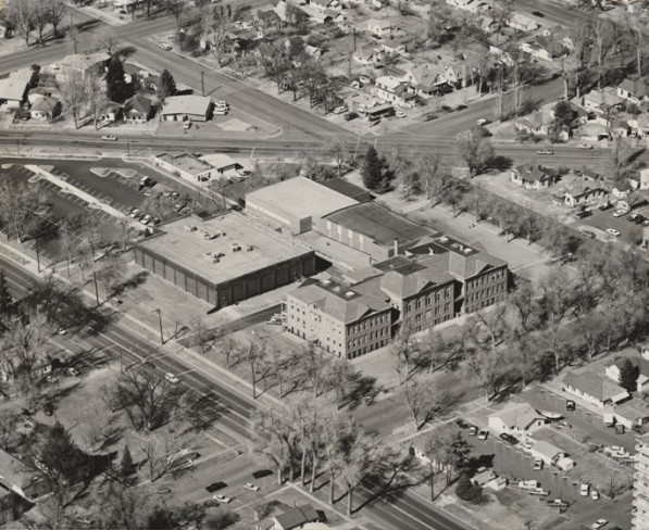 Aerial photo of Lincoln Junior High around 1974, just before it was remade into the Lincoln Center. The Mulberry pool (seen to the left of the school) was newly built. (Photo from the Fort Collins Archive - #H25122.)