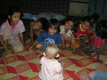Flashback to baby Penny in Cambodia with some new friends.